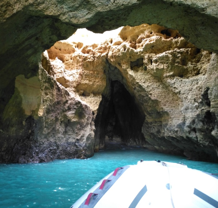 The boat reaches the caves very closely