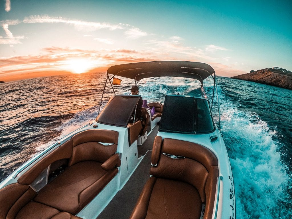 A motorboat and a sunset are just the perfect combo, right?
