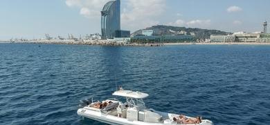 Enjoy the skyline of Barcelona from the sea