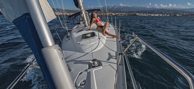 Relax on deck while sailing in Crete