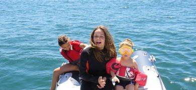 Kids having fun on sailing tour in Lisbon