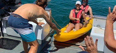Our crew will help you into your kayak