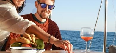 Enjoy the food on a catamaran in Barcelona