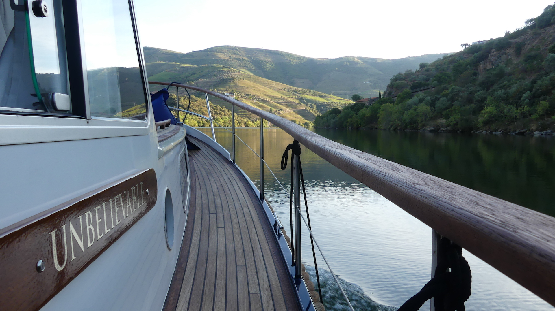 Enjoy the view of the Douro Valley from the river