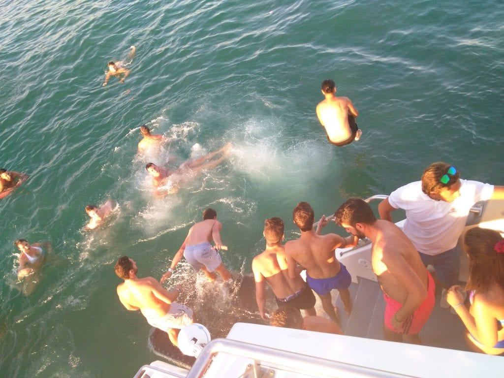 Jump into the Atlantic from the boat party in Albufeira
